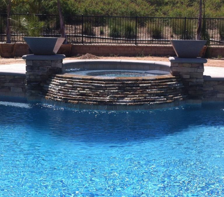 What are the pros and cons of a saltwater pool?