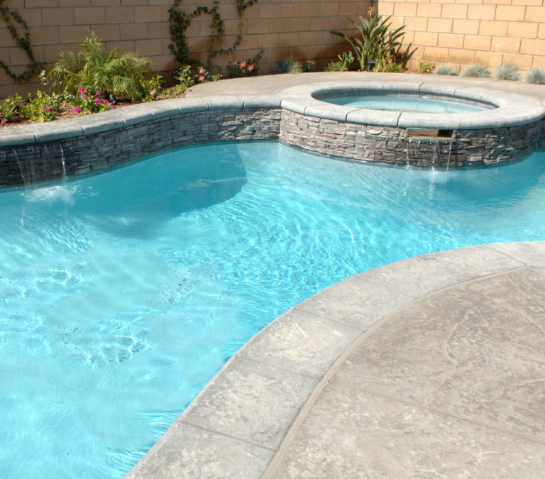 How do I know if my yard is suitable for pool construction?